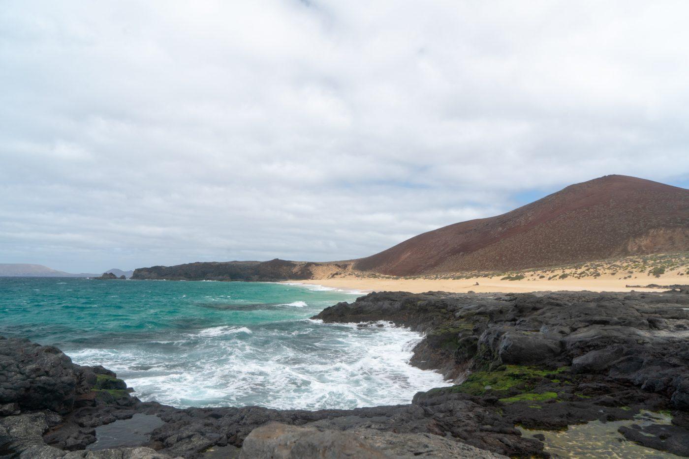 Take the ferry to visit Playa de las Conchas on La Graciosa